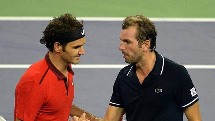 Julien Bennetteau e Roger Federer nella foto