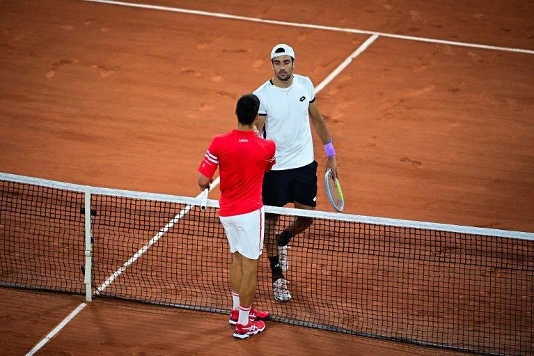 Novak Djokovic e Matteo Berrettini nella foto