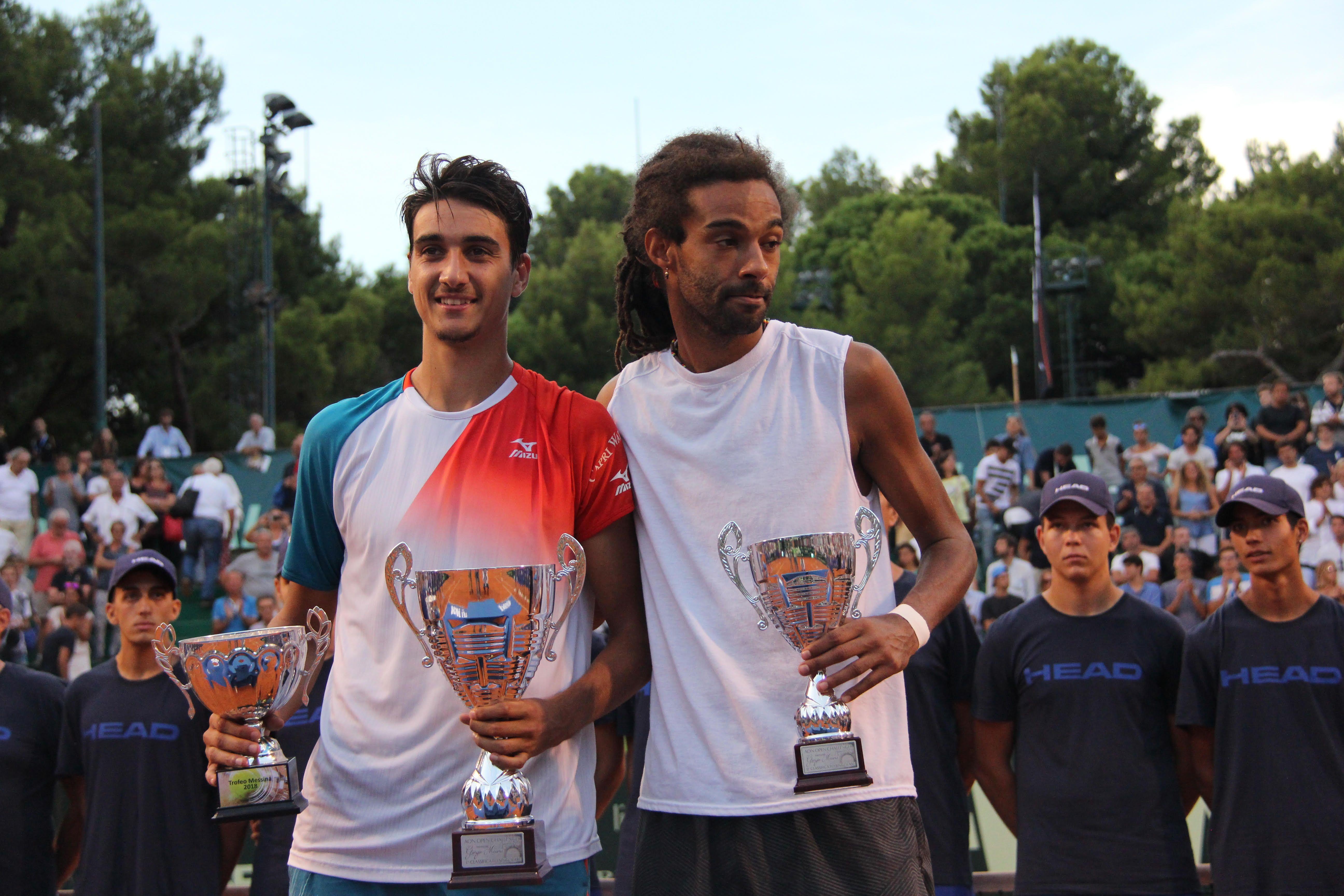 la foto di Lorenzo Sonego a sinistra vincitore della passata edizione e del finalista Dustin Brown
