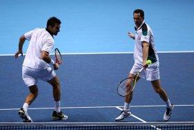Michael Llodra impegnato nella Masters Cup di doppio